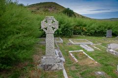 Celtic Cross. In the churchyard of Saint Enodoc Church east of Daymer Bay and near the Village of Trebetherick in Cornwall stock photo