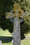 Celtic cross in English churchyard Stock Photo