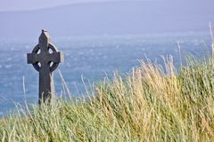 Celtic cross in a field in Inisheer, Ireland Stock Image