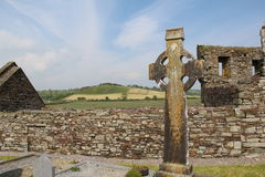 Celtic Cross found along the Wild Atlantic Way. Celtic Cross Wild Atlantic Way background and green landscape of Ireland Location West Cork Timoleague Abbey stock images