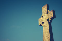 Celtic Cross Gravestone. Celtic Cross Stone Gravestone Against Blue Sky With Copy Space Stock Photos