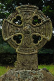 Celtic cross on graveyard. Detail of celtic cross, typicall symbol of scottish graveyard Royalty Free Stock Photos