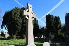 Celtic cross in a graveyard in Ireland. With blue skies Royalty Free Stock Images