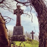 Celtic cross in irish cemetery Royalty Free Stock Images