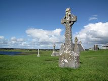 Celtic cross and monastic archeological site of Clonmacnoise in Ireland royalty free stock photo