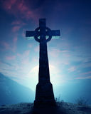 Celtic Cross with moon. On crest of rocky mountain stock images
