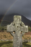 Celtic Cross and Rainbow on the Isle of Skye in Scotland. Royalty Free Stock Image