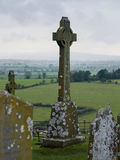 Celtic cross at the rock of Cashel, Ireland. Celtic cross overlooking the countryside at the rock of cashel, Ireland Stock Photo