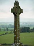 Celtic cross at the rock of Cashel, Ireland. Celtic cross overlooking the countryside at the rock of cashel, Ireland Royalty Free Stock Photography