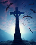 Celtic Cross with swarm of bats Royalty Free Stock Photos