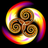 Celtic disk ornament with triple spiral symbol and flames. Royalty Free Stock Images
