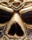 Celtic Druid Skull Face Macro. Close up of an ornate carved celtic skull face Stock Photography