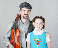Celtic Folk Musician with Daughter Royalty Free Stock Photos