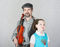 Celtic Folk Performer with Child Royalty Free Stock Photo