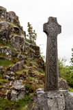 Celtic grave stone on a hill Stock Photo