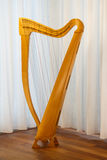Celtic harp with strings standing Royalty Free Stock Images