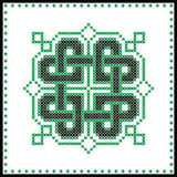 Celtic  knot in black and green cross stitch pattern on white and black background inspired by Irish St Patrick`s day Stock Images