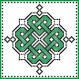 Celtic  knot in cross stitch in green black on white and green background inspired by Irish St Patrick`s day and ancient Scotland Stock Photography