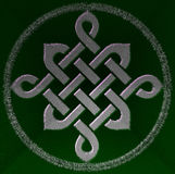 Celtic knot symbol. Celtic green knot mystic religious symbol over black Royalty Free Stock Photos