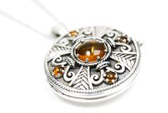 Celtic locket. Celtic silver locket with amber Stock Images