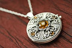 Celtic locket. Celtic silver locket with amber Stock Image