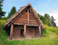 A Celtic log house, Havranok, Slovakia. A summer view of a one-room Celtic log house, in the Havranok archaeoskansen, Liptov region, northern Slovakia. The royalty free stock photography