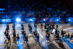 The Celtic Massed Pipes and Drums at the Red Square. MOSCOW, RUSSIA - AUGUST 26, 2016: Spasskaya Tower international military music festival. The Celtic Massed Stock Image