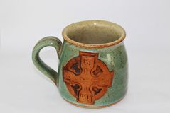 Celtic mug. Traditional celtic design green mug Stock Image
