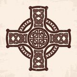 Celtic national cross. Celtic cross with national ornament as interlaced. Old beige background with the aging effect Royalty Free Stock Photos
