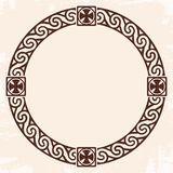 Celtic national ornament. Celtic national circle ornament as interlaced ribbon with crosses. Old beige background with the aging effect Stock Photo