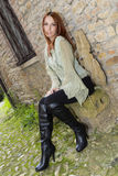 Celtic Red. Stunning redhead model posing as celtic girl in medieval town Stock Images