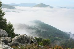Celtic sea view. Standing on  hill in portugal, looking toward the atlantic over a sea of fog in the morning Royalty Free Stock Image
