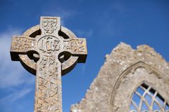 Celtic Stone cross. Stone cross and Athenry Dominican Friary detail,found at 1241 Stock Images