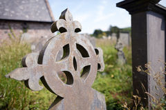 Celtic stone cross in abandoned graveyard Royalty Free Stock Image