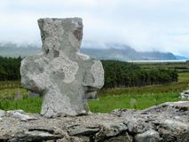Celtic Stone Cross on top of stone wall stock photos