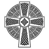Celtic style Cross with eternity knots patterns in white and black with stroke element surrounded by 2 knotted Royalty Free Stock Images