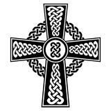 Celtic style Cross with eternity knots patterns in white and black with stroke elements and surrounding rounded knot elements. Celtic style Cross with eternity Stock Images