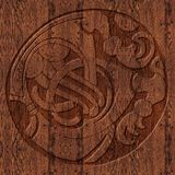 Carved wooden celtic symbol. A celtic symbol carved in oak wood. A two-toned artwork that is suitable for invitations and announcements or as a panel Royalty Free Stock Image