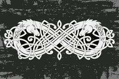 Celtic two-headed dragon. Celtic two-headed dragon with national ornament intertwined ribbon on a gray background with the aging effect Stock Image