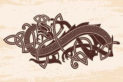 Celtic two-headed dragon. Celtic two-headed dragon with national ornament intertwined ribbon on a beige background with the aging effect Stock Photo