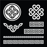 Celtic white knots, braids and patterns on black background Stock Photos