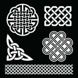 Celtic white knots, braids and patterns on black background - St Patrick's Day Stock Images