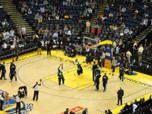Celtics shoot around during pre-game warm-ups. OAKLAND, CA - FEBRUARY 22: Celtics vs. Warriors: Celtics shoot around during pre-game warm-ups  at Oracle Arena Royalty Free Stock Photos