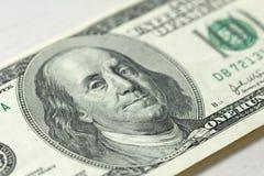 Cem dólares com uma nota 100 dólares Imagem de Stock Royalty Free