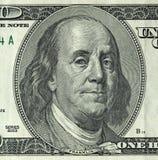 Cem dólares com uma nota 100 dólares Imagens de Stock Royalty Free
