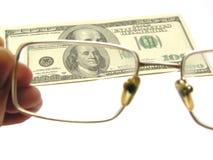 Cem dólares e eyeglasses fotografia de stock
