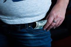 Cem dólares em sua menina das calças de brim do bolso imagem de stock