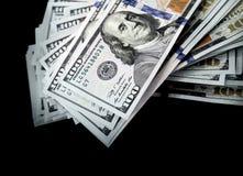 Cem dólares isolados no fundo preto Imagens de Stock Royalty Free