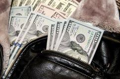 Cem notas de dólar no bolso Imagens de Stock