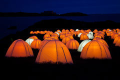 Cemaes Bay Peace Camp. An artwork of lighted tents and poetry bring read throughout the night Isle of Anglesey Stock Images